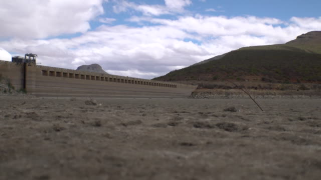 empty dam due to drought in south africa - dry stock videos & royalty-free footage