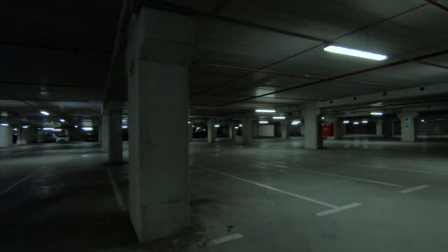 empty dark underground parking - cement stock videos & royalty-free footage