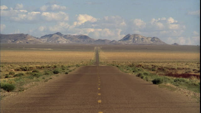 ws, empty desert highway with mountains in distance, tonopah, nevada, usa - eternity stock videos & royalty-free footage