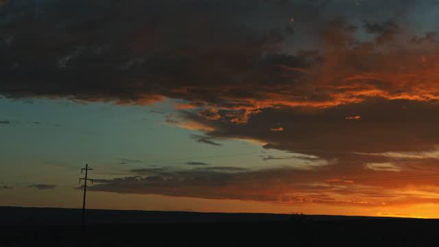 empty desert road in canyon land utah at sunset - utah stock videos & royalty-free footage
