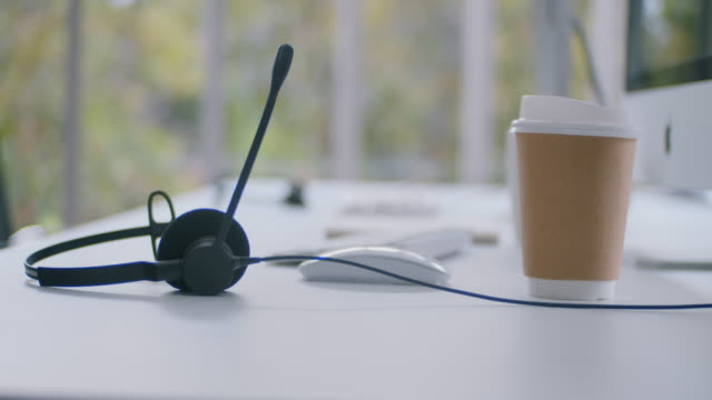 empty desks in a call centre office - headset stock videos & royalty-free footage