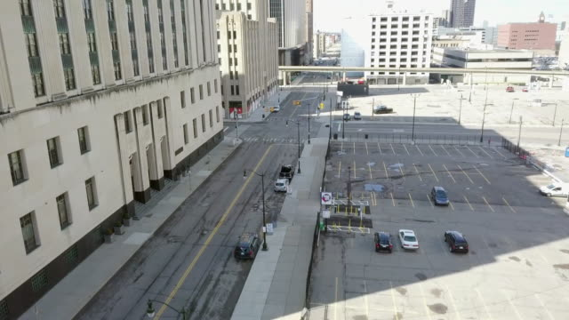 empty detroit street during the covid-19 pandemic - car park stock videos & royalty-free footage