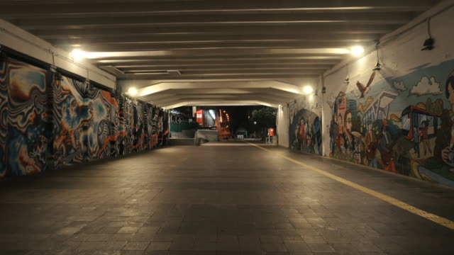 empty downtown jakarta tunnel street during the covid-19 pandemic - building activity stock videos & royalty-free footage