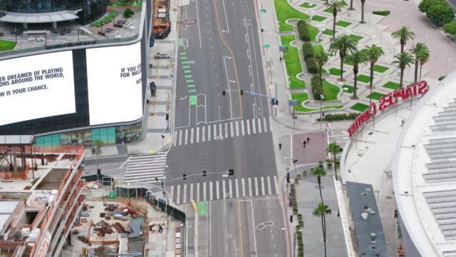 empty downtown los angeles street during the covid-19 pandemic - staples center video stock e b–roll