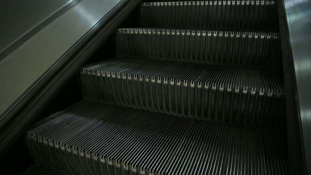 empty escalator at a train station during coronavirus covid-19 lockdown in london when public transport and travel was quiet and deserted with no people in england, europe - paddington railway station stock videos & royalty-free footage