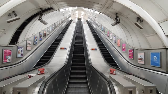 empty escalators at bond street tube station during the coronavirus pandemic on march 18 2020 in london england - brian dayle coronavirus stock videos & royalty-free footage
