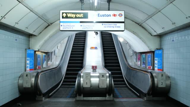 empty euston underground station escalators during lockdown for coronavirus pandemic in london, england, uk, on wednesday, april 22, 2020. - no people stock videos & royalty-free footage