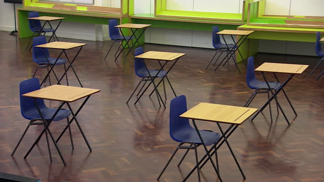 empty exam hall at wolverhampton school, as exams are cancelled due to national lockdown due to coronavirus pandemic - furniture stock videos & royalty-free footage
