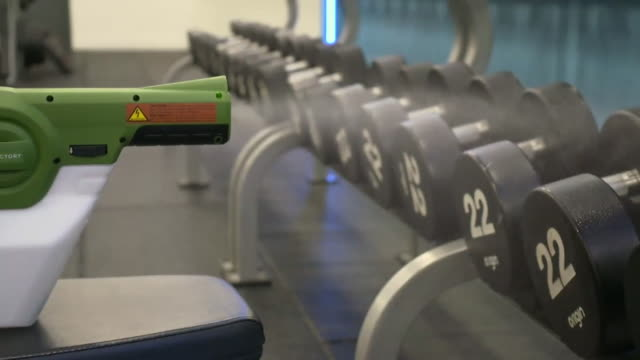 empty exercise machines and weights being disinfected as they prepare to reopen following coronavirus lockdown - exercise equipment stock videos & royalty-free footage