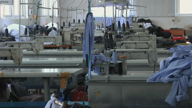 ws empty factory floor with rows of sewing machines not being used / ningbo, zhejiang, china - abandoned stock videos & royalty-free footage