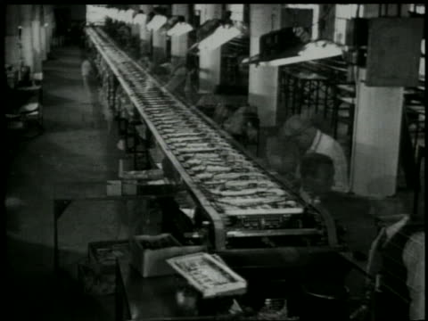 b/w 1929 empty factory with conveyor / workers dissolve into shot - 1929 stock videos and b-roll footage
