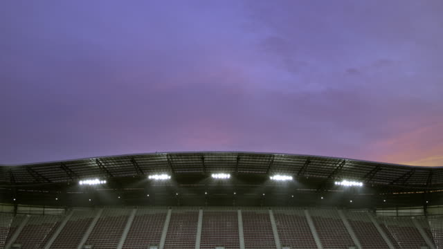 td empty football stadium at dusk - floodlight stock videos & royalty-free footage