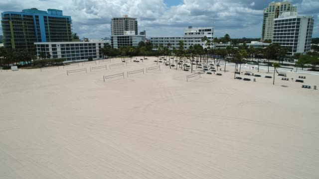 empty fort lauderdale beach during covid-19 pandemic - dutcheraerials covid stock videos & royalty-free footage
