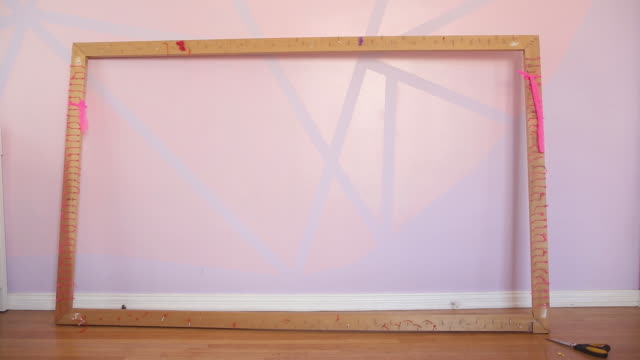 empty frame in artist pink studio - bricolage video stock e b–roll