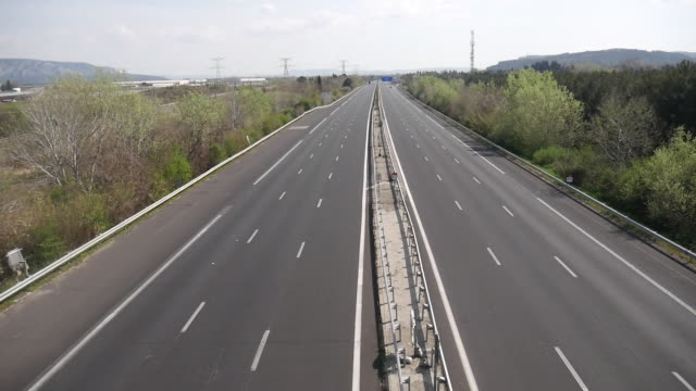 empty french highway due to covid19 in the south of france - mehrspurige strecke stock-videos und b-roll-filmmaterial
