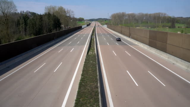 empty german motorway a8 thanks to exit restriction - motorway stock videos & royalty-free footage