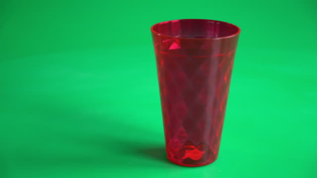 empty glass on green screen