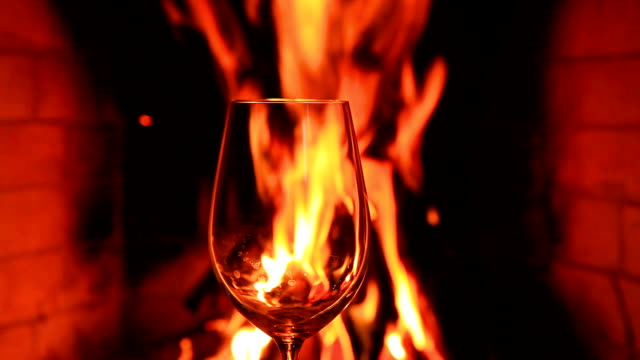 Empty glass on the background of the fireplace