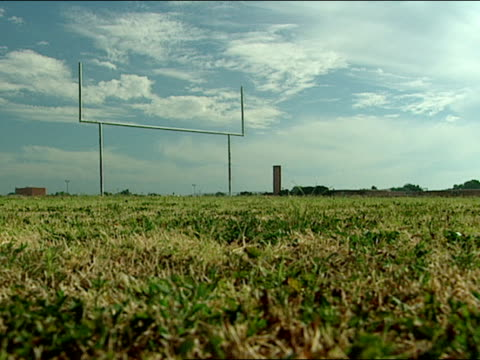 empty grass football field and goal post ls of field with post - football goal post stock videos and b-roll footage
