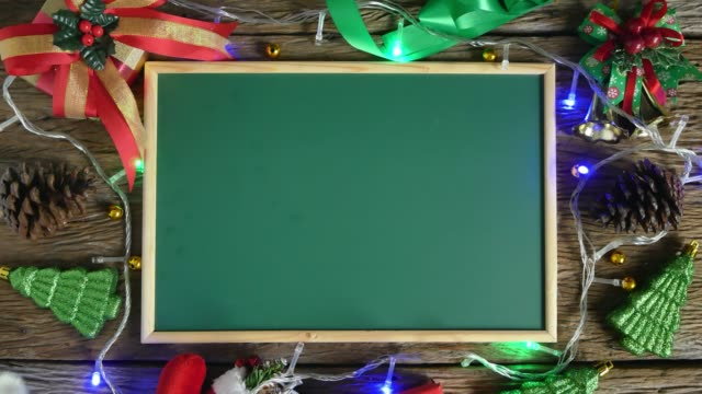 empty green board placed on wooden table decorated with christmas decorations. top view - blackboard stock videos & royalty-free footage