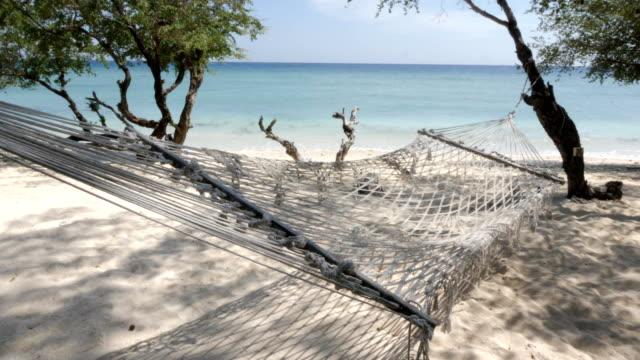 empty hammock swinging at the beach in gili trawangan island in bali - swing stock videos & royalty-free footage