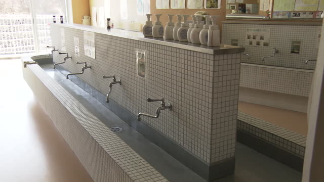 empty handwashing place at school, japan - timer stock videos & royalty-free footage