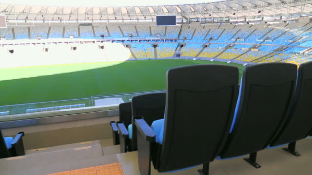 empty maracana stadium and pitch from top of the stands - dugout stock videos & royalty-free footage