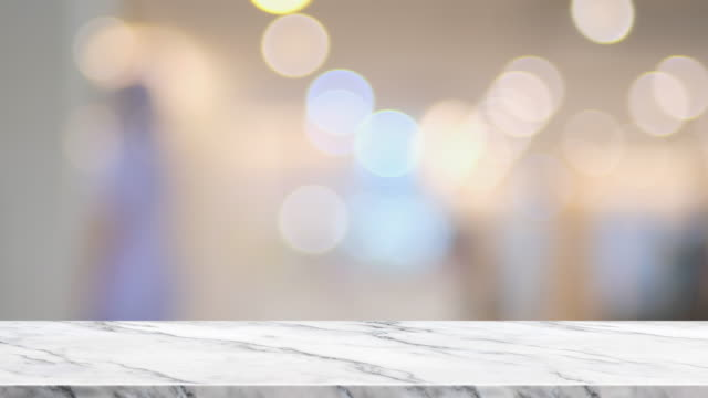 empty marble table with blur people at hospital bokeh light background.copy space for adding element or product - desk stock videos & royalty-free footage