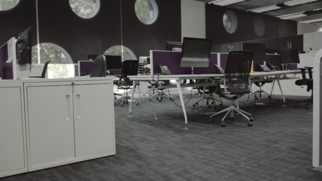 empty modern office with no people during lockdown covid19 pandemic and economic downturn - landline phone stock videos & royalty-free footage