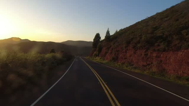 empty mountain road at sunset in california. - winding road stock videos & royalty-free footage