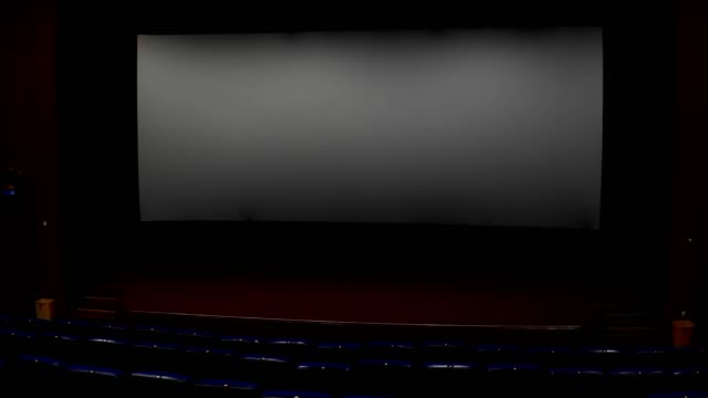 empty movie theater with a blank screen - stage performance space stock videos & royalty-free footage