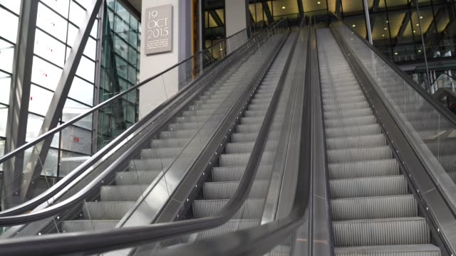 august 02: empty office escalators in the city of london on august 02, 2020 in london, england the future of offices in the uk is looking uncertain... - employment issues stock videos & royalty-free footage