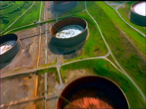 aerial empty oil storage tanks / whiddy island, county cork, ireland - 1997年点の映像素材/bロール