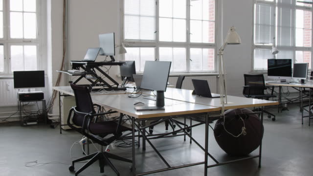 empty open plan office with work stations - new business stock videos & royalty-free footage