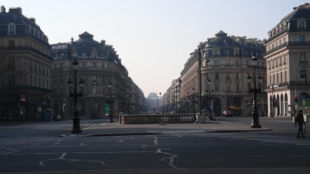 empty opera avenue is filmed on march 28, 2020 in paris, france. the country has introduced fines for people caught violating its nationwide lockdown... - paris france stock videos & royalty-free footage