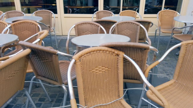 empty outdoor dining chairs during coronavirus epidemic lockdown - food and drink establishment stock videos & royalty-free footage
