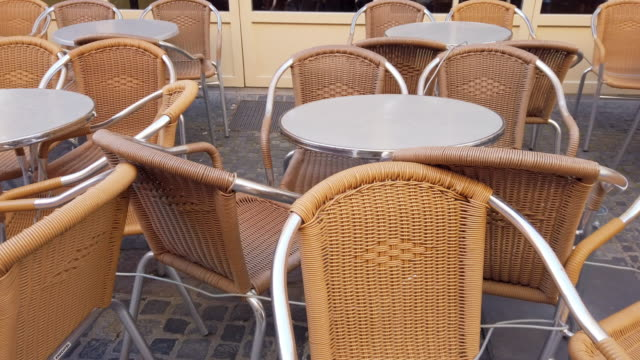 empty outdoor dining chairs during coronavirus epidemic lockdown - absence stock videos & royalty-free footage