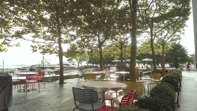 empty outdoor restaurant seating area with by the hudson river in lower manhattan during the reopening phase of the coronavirus pandemic on august... - lens flare stock videos & royalty-free footage