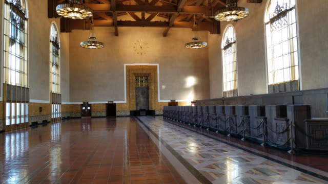 empty part of union station that was the ticketing counters in the past camera pans the hall downtown los angeles california train station - union station los angeles stock videos & royalty-free footage