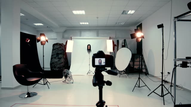 empty photo studio with photo equipment - photograph stock videos & royalty-free footage