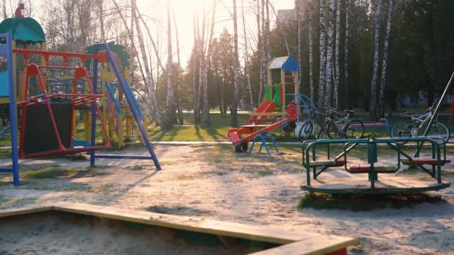 vídeos de stock e filmes b-roll de empty playground during covid 19 - epidemiologia