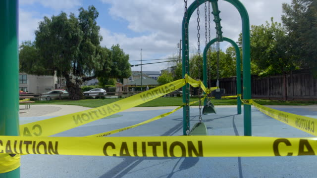 empty playground in mountain view, california at coronavirus pandemic time. - parco giochi video stock e b–roll