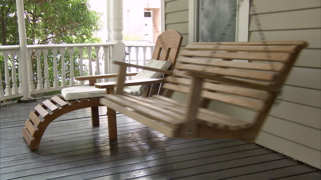 ms  empty porch swing swinging - chair stock videos & royalty-free footage