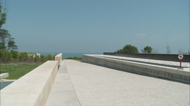 ws pan empty promenade, omaha beach, colleville-sur-mer, normandy, france - omaha beach stock videos and b-roll footage