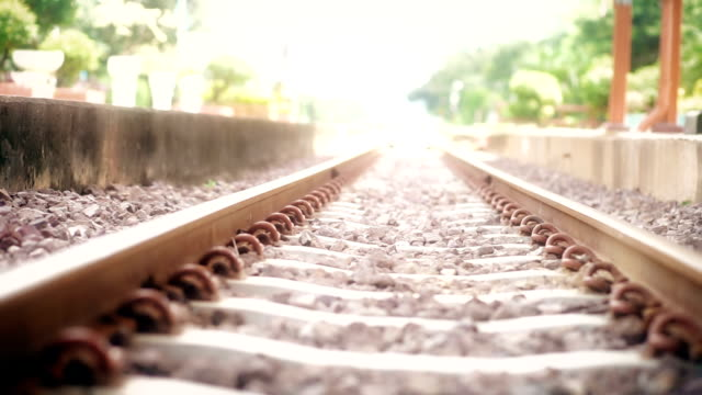 Empty railroad tracks at station.