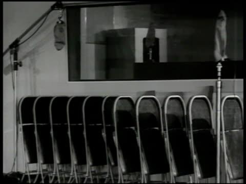 empty recording studio piano microphones chairs ext cu sign 'columbia records' int ms inventor peter c goldmark w/ men looking over recording machine... - inspelningsstudio bildbanksvideor och videomaterial från bakom kulisserna