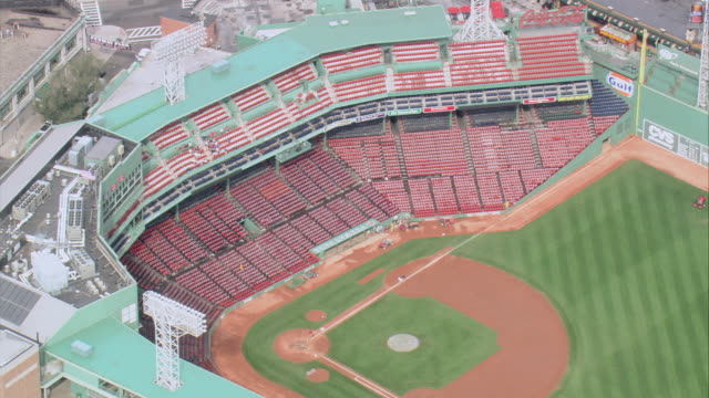 AERIAL Empty red seats and well manicured green field of Fenway Park baseball stadium / Boston, Massachusetts, United States