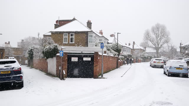 empty residential streets colston road and penrhyn crescent with parked cars in snow during lockdown for coronavirus pandemic in london, england, uk,... - snow stock videos & royalty-free footage
