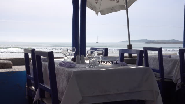 Empty restaurant table at the sea