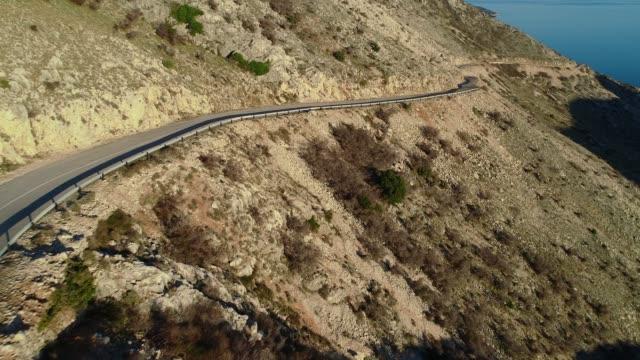 empty road across arid mediterranean countryside - coastal road stock videos & royalty-free footage
